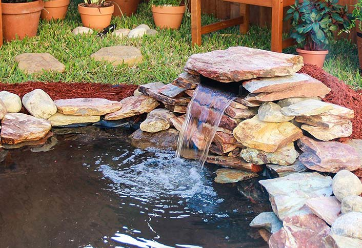 Selecting the right water garden pumps for your pond at for Homemade water pump for pond