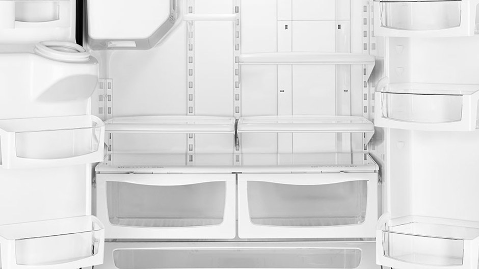 Empty interior of the refrigerator. Both doors are open.