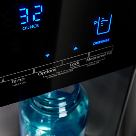 Water dispenser with digital display reading 32 ounces.