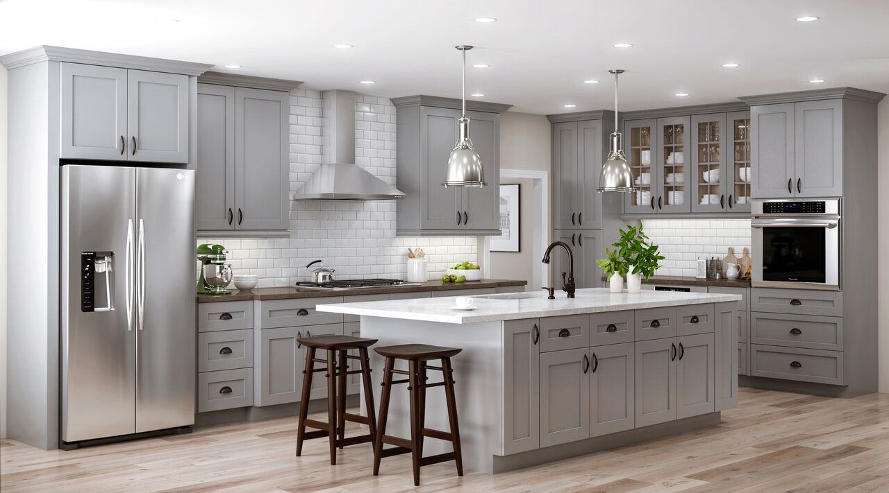 Kitchen With Slate Gray Floors And Oak Cabinets